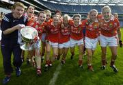 1 October 2006; Cork Liasion Officer Eileen O'Brien celebrates with players, from left, Ciara Walsh, Briege Corkery, Angela Walsh, Mary O'Conor, Caoimhe Creedon, Elaine O'Riordan, Valrie Mulcahy, Sinead O'Reilly and Brid Stack, and the Brendan Martin Cup after the game. TG4 Ladies All-Ireland Senior Football Championship Final, Cork v Armagh, Croke Park, Dublin. Picture credit: Brendan Moran / SPORTSFILE