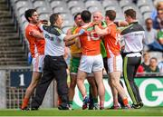 9 August 2014; Donegal team doctor Kevin Moran tries to seperate Armagh's Aaron Findon, left, Aidan Forker and Finnian Moriarty, right, from Donegal's Karl Lacey. GAA Football All-Ireland Senior Championship, Quarter-Final, Donegal v Armagh, Croke Park, Dublin. Picture credit: Stephen McCarthy / SPORTSFILE