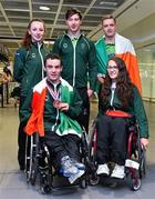 11 August 2014; The Allianz Irish Paralympic Swim team on their return home from the 2014 Paralympic Swimming (IPC) European Championship in Eindhoven, where they won two bronze medals, and recorded six personal best and six season's best times. Pictured are, back row, from left, Ellen Keane, from Clontarf, Co. Dublin, Laurence McGivern, from Rostrevor, Co. Down and Jonathan McGrath, from Limerick. Front row, James Scully, from Ratoath, Co. Meath and Ailbhe Kelly, from Castleknock, Dublin. 2014 IPC Swimming European Championships Paralympic Swimmers Return from 2014 IPC Swimming European Championships, Dublin Airport, Dublin. Picture credit: Ramsey Cardy / SPORTSFILE