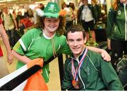 11 August 2014; The Allianz Irish Paralympic Swim team on their return home from the 2014 Paralympic Swimming (IPC) European Championship in Eindhoven, where they won two bronze medals, and recorded six personal best and six season's best times. Pictured are, double bronze medalist James Scully, from Ratoath, Co. Meath and Laura McGrath, aged 11, from Limerick. 2014 IPC Swimming European Championships Paralympic Swimmers Return from 2014 IPC Swimming European Championships, Dublin Airport, Dublin. Picture credit: Ramsey Cardy / SPORTSFILE