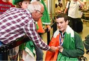 11 August 2014; The Allianz Irish Paralympic Swim team on their return home from the 2014 Paralympic Swimming (IPC) European Championship in Eindhoven, where they won two bronze medals, and recorded six personal best and six season's best times. Pictured are, double bronze medalist James Scully, from Ratoath, Co. Meath and Christie McGrath, from Limerick. 2014 IPC Swimming European Championships Paralympic Swimmers Return from 2014 IPC Swimming European Championships, Dublin Airport, Dublin. Picture credit: Ramsey Cardy / SPORTSFILE