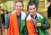 11 August 2014; The Allianz Irish Paralympic Swim team on their return home from the 2014 Paralympic Swimming (IPC) European Championship in Eindhoven, where they won two bronze medals, and recorded six personal best and six season's best times. Pictured are, double bronze medalist James Scully, from Ratoath, Co. Meath with his father Mick. 2014 IPC Swimming European Championships Paralympic Swimmers Return from 2014 IPC Swimming European Championships, Dublin Airport, Dublin. Picture credit: Ramsey Cardy / SPORTSFILE