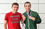 11 August 2014; The Allianz Irish Paralympic Swim team on their return home from the 2014 Paralympic Swimming (IPC) European Championship in Eindhoven, where they won two bronze medals, and recorded six personal best and six season's best times. Pictured is double bronze medalist James Scully, from Ratoath, Co. Meath, with brother Luke. 2014 IPC Swimming European Championships Paralympic Swimmers Return from 2014 IPC Swimming European Championships, Dublin Airport, Dublin. Picture credit: Ramsey Cardy / SPORTSFILE