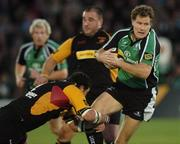 13 October 2006; Matt Mostyn, Connacht, is tackled by Ben Daly, Newport Gwent Dragons. Magners League, Connacht v Newport Gwent Dragons, Sportsground, Galway. Picture credit: Ray Ryan / SPORTSFILE