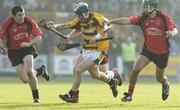 15 October 2006; Nigel Higgins, Rathnure, in action against, from left, Denis Morton, Laurence Prendergast and Keith Rossiter, Oulart-the-Ballagh. Wexford Senior Hurling Championship Final, Oulart-the-Ballagh v Rathnure, Wexford Park, Co. Wexford. Picture credit: Pat Murphy / SPORTSFILE