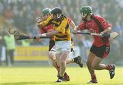15 October 2006; Nigel Higgins, Rathnure, in action against Laurence Prendergast and Keith Rossiter, right, Oulart-the-Ballagh. Wexford Senior Hurling Championship Final, Oulart-the-Ballagh v Rathnure, Wexford Park, Co. Wexford. Picture credit: Pat Murphy / SPORTSFILE