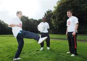 18 October 2006; At a photocall to launch the FAI's Football Against Racism in Europe (FARE) week are, left to right, Andrei Francesco Georgescu, Bray Wanderers, Emeka Onwubiko, St. Kevins Boys, Dublin, and Alan Reynolds, Waterford United. The FAI encourages all members of the association to make strong efforts to contribute actively to this anti-racism campaign in football. Merrion Square, Dublin. Picture credit: David Maher / SPORTSFILE
