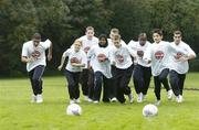 18 October 2006; At a photocall to launch the FAI's Football Against Racism in Europe (FARE) week are, left to right, Rudland Ratzsch, St. Tiernans CS, Dubin, Aura Jurciukonyte, St. Gabriels NS, Dubin, Patrick Collins, Pavee Point, Huda AbdiHassir Dahir, St.Gabriels NS, Dublin, Alan Reynolds, Waterford United, Paul Murphy, St, Gabriels NS, Dublin, Emeka Onwubiko, St, Kevins Boys, Gabriel Morarasu, St.Gabriels NS, Dublin and Andrei Francescu Georgescu, Bray Wanderers. The FAI encourages all members of the association to make strong efforts to contribute actively to this anti-racism campaign in football. Merrion Square, Dublin. Picture credit: David Maher / SPORTSFILE