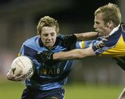 26 October 2006; Craig Rogers, UCD, is tackled by Nicky McGrath, Kilmacud Crokes. Dublin Senior Football Championship Semi-Final, UCD v Kilmacud Crokes, Parnell Park, Dublin. Picture credit: David Maher / SPORTSFILE