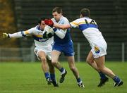 19 November 2006; Enda Muldoon, Ballinderry, is tackled by Eoin Gormley and David Harte, Errigal Chiarain. AIB Ulster Senior Football Championship Semi-Final, Errigal Chiarain v Ballinderry, Casement  Park, Belfast. Picture credit: Oliver McVeigh / SPORTSFILE