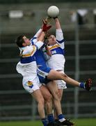19 November 2006; Eoin Gormley and Peter Loughran, Errigal Chiarain, in action against Enda Muldoon, Ballinderry. AIB Ulster Senior Football Championship Semi-Final, Errigal Chiarain v Ballinderry, Casement  Park, Belfast. Picture credit: Oliver McVeigh / SPORTSFILE
