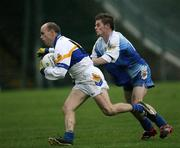 19 November 2006; Peter Canavan, Errigal Chiarain, in action against Raymond Wilkinson, Ballinderry. AIB Ulster Senior Football Championship Semi-Final, Errigal Chiarain v Ballinderry, Casement  Park, Belfast. Picture credit: Oliver McVeigh / SPORTSFILE