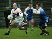 19 November 2006; Peter Canavan, Errigal Chiarain, in action against Nial McCusker, Ballinderry. AIB Ulster Senior Football Championship Semi-Final, Errigal Chiarain v Ballinderry, Casement  Park, Belfast. Picture credit: Oliver McVeigh / SPORTSFILE