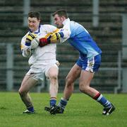 19 November 2006; Enda McGinley, Errigal Chiarain, in action against James Conway, Ballinderry. AIB Ulster Senior Football Championship Semi-Final, Errigal Chiarain v Ballinderry, Casement  Park, Belfast. Picture credit: Oliver McVeigh / SPORTSFILE
