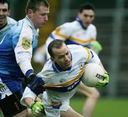 19 November 2006; Pascal Canavan, Errigal Chiarain, in action against Nial McCusker, Ballinderry. AIB Ulster Senior Football Championship Semi-Final, Errigal Chiarain v Ballinderry, Casement  Park, Belfast. Picture credit: Oliver McVeigh / SPORTSFILE
