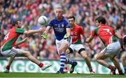 24 August 2014; Kieran Donaghy, Kerry, lays off a pass in between Mayo defenders Keith Higgins, left, and Ger Cafferkey, which was caught by James O'Donoghue who went on to score Kerry's only goal of the game. GAA Football All-Ireland Senior Championship, Semi-Final, Kerry v Mayo, Croke Park, Dublin. Picture credit: Brendan Moran / SPORTSFILE