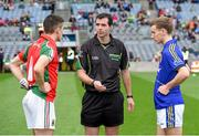 24 August 2014; Referee Seán Hurson performs the coin toss in the company of team captains Cian Hanley, left, Mayo and Dan O'Donoghue, Kerry. Electric Ireland GAA Football All Ireland Minor Championship, Semi-Final, Kerry v Mayo, Croke Park, Dublin. Picture credit: Brendan Moran / SPORTSFILE