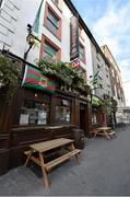 29 August 2014; Kerry and Mayo flags fly outside Flannery's Bar on the Cecil Street in Limerick City ahead of the GAA Football All-Ireland Senior Championship Semi-Final Replay between Kerry and Mayo. Picture credit: Diarmuid Greene / SPORTSFILE