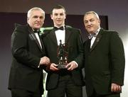 24 November 2006; Keith Higgins, Mayo, is presented with his Young Footballer of the Year award by An Taoiseach Bertie Ahern T.D. and Nickey Brennan, President of the GAA, at the 2006 Vodafone GAA All-Star Awards. Citywest Hotel, Dublin. Picture credit: Brendan Moran / SPORTSFILE