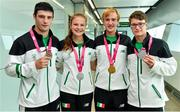 30 August 2014; Team Ireland's, from left: Michael Gallagher, from Finn Valley, Co. Donegal, who won a Bronze medal in Heavyweight boxing; Ciara Ginty, from Geesala, Co. Mayo, who won a Silver medal in lightweight boxing; Michael  Duffy, from Ballina, Co. Mayo, who won a Gold Medal for Team Mix Europe; and Robert Hendrick, from Donadea, Co. Kildare, who won a Silver medal, C1 Obstacle Slalom canoeing, pictured at Dublin Airport on their return from World Youth Olympics in China. Dublin Airport, Dublin. Picture credit: Ramsey Cardy / SPORTSFILE