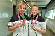 30 August 2014; Team Ireland's Michael  Duffy, from Ballina, Co. Mayo, who won a Gold Medal for Team Mix Europe, left, and Ciara Ginty, from Geesala, Co. Mayo, who won a Silver medal in lightweight boxing, pictured at Dublin Airport on their return from World Youth Olympics in China. Dublin Airport, Dublin. Picture credit: Ramsey Cardy / SPORTSFILE