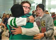 30 August 2014; Team Ireland's Robert Hendrick, from Donadea, Co. Kildare, who won a Silver medal, C1 Obstacle Slalom canoeing, is greeted by family members at Dublin Airport on their return from World Youth Olympics in China. Dublin Airport, Dublin. Picture credit: Ramsey Cardy / SPORTSFILE