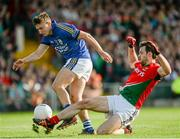 30 August 2014; Ger Cafferkey, Mayo, fouls James O'Donoghue, Kerry, which resulted in Kerry's second penalty. GAA Football All Ireland Senior Championship, Semi-Final Replay, Kerry v Mayo, Gaelic Grounds, Limerick. Picture credit: Dáire Brennan / SPORTSFILE