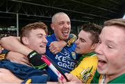 30 August 2014; Kerry's Kieran Donaghy, centre, and James O'Donoghue celebrate with fans after the final whistle. GAA Football All Ireland Senior Championship, Semi-Final Replay, Kerry v Mayo. Gaelic Grounds, Limerick. Picture credit: Stephen McCarthy / SPORTSFILE