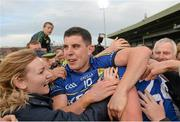 30 August 2014; Kerry's Michael Geaney celebrates with fans after the final whistle. GAA Football All Ireland Senior Championship, Semi-Final Replay, Kerry v Mayo. Gaelic Grounds, Limerick. Picture credit: Stephen McCarthy / SPORTSFILE