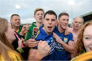 30 August 2014; Kerry's Michael Geaney, left, and Jonathan Lyne celebrate with fans after the final whistle. GAA Football All Ireland Senior Championship, Semi-Final Replay, Kerry v Mayo. Gaelic Grounds, Limerick. Picture credit: Stephen McCarthy / SPORTSFILE