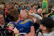 30 August 2014; Kerry's Kieran Donaghy embraces teammate David Moran following their side's victory. GAA Football All Ireland Senior Championship, Semi-Final Replay, Kerry v Mayo. Gaelic Grounds, Limerick. Picture credit: Stephen McCarthy / SPORTSFILE