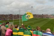 30 August 2014; A general view of a Kerry supporter waving her flag as the teams follow the Artane School of Music Band during the pre-match parade before the game. GAA Football All Ireland Senior Championship, Semi-Final Replay, Kerry v Mayo, Gaelic Grounds, Limerick. Picture credit: Barry Cregg / SPORTSFILE