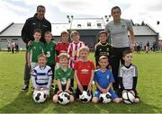 31 August 2013; Lucan United football club were the lucky winners of the McDonald's FAI Future Football Coaching Session with John O'Shea which took place this Sunday 31st of August at Lucan United Football Grounds. Lucan United football club member Kate Kennedy was the lucky winner and along with the coaching session for her club, she also received McDonald's vouchers and premium tickets to the Republic of Ireland versus Gilbraltar game on October 11th in the Aviva where she will have the chance to meet the players. Republic of Ireland star John O'Shea was joined by Adrian Crean, MD McDonald's Ireland, John Delaney, CEO FAI, Gerry Hayden, McDonald's Restaurant Lucan and John Doyle, Chairman of Lucan United to help Kate celebrate her win! The McDonald's FAI Future Football Programme consists of 24 fun days, followed by regional days and an overall final on the 11th of October. For further information, visit http://mcdonaldsfuturefootball.fai.ie. Pictured are Republic of Ireland star John O'Shea with coach Stephen Rice and back row, from left, Michael Gartland, Cian Nolan, Matthew McEvoy, Zarah Kennelly and Arno Freimanis; front row, from left, Daniel Whitmore, Cathal Conway, Cian Moran, Jamie Cassells and Dylan Molloy. Lucan United FC, Lucan, Co. Dublin. Picture credit: Barry Cregg / SPORTSFILE