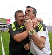 31 August 2014; Donegal manager Jim McGuinness celebrates with kitman Joe McCloskey at the end of the game. GAA Football All Ireland Senior Championship, Semi-Final, Dublin v Donegal, Croke Park, Dublin. Picture credit: David Maher / SPORTSFILE