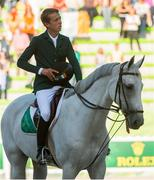 "2 September 2014; Nineteen year old Bertram Allen, from Co. Wexford, who won the opening competition of The World Equestrian Games riding Molly Malone V stands to attention as the National Anthem ""Amhrán na bhFiann"" is played. 2014 Alltech FEI World Equestrian Games, Caen, France. Picture credit: Ray McManus / SPORTSFILE"