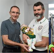 2 September 2014; Republic of Ireland manager Martin O'Neill, left, and assistant manager Roy Keane with 3 month old Realtaoin O'Lone, from Tyrrelstown, Co. Dublin, during a visit to Temple Street Childrens Hospital, Dublin. Picture credit: David Maher / SPORTSFILE