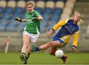 6 September 2014; Caroline Little, Fermanagh, shoots to score her side's fifth goal despite the efforts of Roscommon goalkeeper Richael Timothy. TG4 All-Ireland Ladies Football Intermediate Championship Semi-Final, Fermanagh v Roscommon. Pearse Park, Longford. Picture credit: Paul Mohan / SPORTSFILE