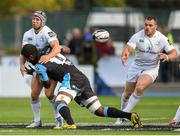 6 September 2014; Isaac Boss offloads to Leinster team-mate Cian Healy as he is tackled by Leone Nakarawa, Glasgow Warriors. Guinness PRO12, Round 1, Glasgow Warriors v Leinster. Scotstoun Stadium, Glasgow, Scotland. Picture credit: Stephen McCarthy / SPORTSFILE