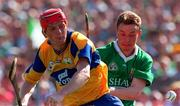 16 June 1996; Brian Lohan of Clare in action against Owen O'Neill of Limerick during the Munster GAA Hurling Senior Championship Semi-Final match between Limerick and Clare at Gaelic Grounds in Limerick. Photo by David Maher/Sportsfile
