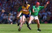 16 June 1996; Frank Lohan of Clare in action against TJ Ryan of Limerick during the Munster GAA Hurling Senior Championship Semi-Final match between Limerick and Clare at Gaelic Grounds in Limerick. Photo by David Maher/Sportsfile