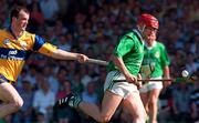 16 June 1996; T.J. Ryan of Limerick in action against Ollie Baker of Clare during the Munster GAA Hurling Senior Championship Semi-Final match between Limerick and Clare at Gaelic Grounds in Limerick. Photo by David Maher/Sportsfile