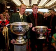27 September 1999; Meath captain Graham Geraghty, holding the Sam Maguire Cup, and the victorious Down minor captain Liam Doyle, holding the Tom Markham Cup, during the Bank of Ireland All-Ireland Senior Football Championship Final Post Match Reception at the Burlington Hotel in Ballsbridge, Dublin. Photo by Brendan Moran/Sportsfile