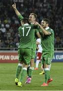 7 September 2014; Aiden McGeady, centre, Republic of Ireland, celebrates after scoring his side's second and winning goal with team-mate's Robbie Brady and Stephen Ward. UEFA EURO 2016 Championship Qualifer, Group D, Georgia v Republic of Ireland. Boris Paichadze National Arena, Tbilisi, Georgia. Picture credit: David Maher / SPORTSFILE