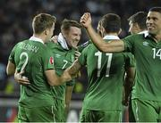 7 September 2014; Aiden McGeady, second from left, Republic of Ireland, celebrates after scoring his side's second and winning goal with team-mate's Seamus Coleman, Robbie Brady and Jonathan Walters. UEFA EURO 2016 Championship Qualifer, Group D, Georgia v Republic of Ireland. Boris Paichadze National Arena, Tbilisi, Georgia. Picture credit: David Maher / SPORTSFILE
