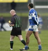 28 January 2007; Darren Rooney, Laois, is sent off by referee Derek Fahy, after being shown a second yellow card. O'Byrne Cup Final, Laois v Dublin, O'Connor Park, Tullamore, Co. Offaly. Picture Credit: David Maher / SPORTSFILE