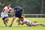 13 September 2014; Jordan Lamour, Leinster, is tackled by Matthew McDowell, left, and Jack Howard, Ulster. Under 18 Schools Interprovincial, Leinster v Ulster, St. Mary's RFC, Templeville Road, Dublin. Picture credit: Barry Cregg / SPORTSFILE