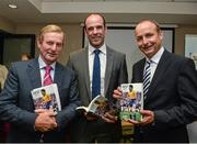 """16 September 2014; An Taoiseach Enda Kenny, T.D., left, with Dermot Earley junior and Fianna Fail leader Michael Martin T.D., right, officially launched the authorised Biography of the Late Dermot Earley, entitled """"Dermot Earley, An Officer And A Gentleman"""" by John Scally. Croke Park, Dublin. Picture credit: David Maher / SPORTSFILE"""