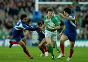 11 February 2007; Gordon D'Arcy, Ireland, in action against Clement Poitrenaud, left, and Christophe Dominici, France. RBS Six Nations Rugby Championship, Ireland v France, Croke Park, Dublin. Picture Credit: Brendan Moran / SPORTSFILE