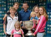 20 September 2014; Dara Ó Cinnéide is the latest to feature on the Bord Gáis Energy Legends Tour Series 2014 when he gave a unique tour of the Croke Park stadium and facilities this week. Pictured is Dara Ó Cinnéide with Orla, Diarmuid, Gerry, Dara Claire and Cora O'Mahony from Ballybunion, Co. Kerry, and the Sam Maguire cup. Croke Park, Dublin. Picture credit: Paul Mohan / SPORTSFILE