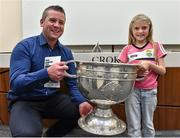 20 September 2014; Dara Ó Cinnéide is the latest to feature on the Bord Gáis Energy Legends Tour Series 2014 when he gave a unique tour of the Croke Park stadium and facilities this week. Pictured is Dara Ó Cinnéide with six year old Orla O'Mahony from Ballybunion, Co. Kerry, and the Sam Maguire cup. Croke Park, Dublin. Picture credit: Paul Mohan / SPORTSFILE